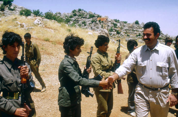 PKK's General Secretary and military leader Abdullah Ocalan greets women soldiers at the Mahsun Korkmaz Academy military training camp.   Location: Lebanon. (Photo by Maher Attar/Sygma via Getty Images)