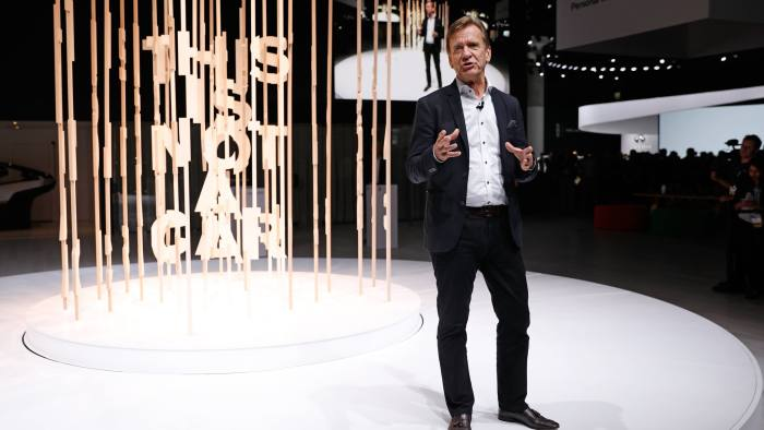 """Hakan Samulesson, President and CEO, Volvo Car Group, speaks in front of a spinning art display made of wood spelling out """"This is not a car."""" during a Volvo press conference at the Los Angeles Auto Show in Los Angeles, California, U.S. November 28, 2018. REUTERS/Mike Blake - HP1EEBS1KHD86"""