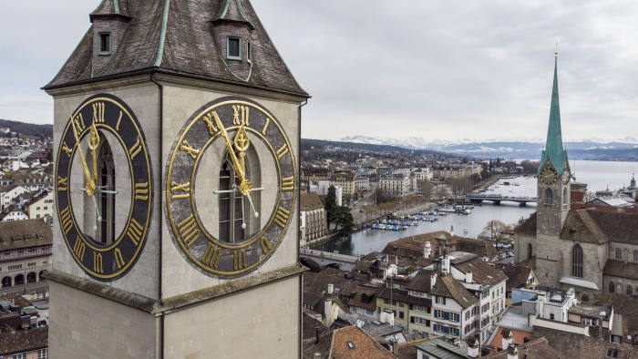 Europe's largest church clock of the church of St. Peter is set to five minutes before twelve in Zurich, Switzerland, Tuesday, March 12, 2019 to protest against climate change. (Ennio Leanza/Keystone via AP)