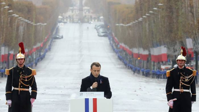 MAXPPP OUT Mandatory Credit: Photo by LUDOVIC MARIN/POOL/EPA-EFE/REX/Shutterstock (9973500cv) French President Emmanuel Macron (C) delivers a speech during the international ceremony for the Centenary of the WWI Armistice of 11 November 1918 at the Arc de Triomphe, in Paris, France, 11 November 2018. Heads of State and Government commemorate their fallen soldiers in France. Commemoration of the Centenary of the end of the First World War, Paris, France - 11 Nov 2018