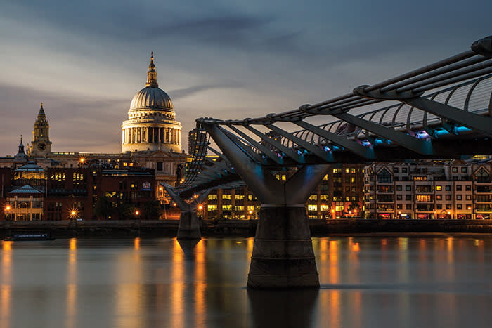 View of buildings along the Thames waterfront by the Millennium Bridge in London, with St Paul's Cathedral visible in the background, taken on July 15, 2013. (Photo by Claire Gillo/PhotoPlus Magazine via Getty Images)