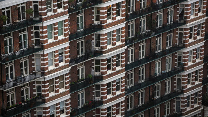 Flowers sit in pots as they stand on the balconies of residential apartment blocks in the Westminster district of London, U.K., on Wednesday, Oct. 29, 2014. U.K. house price growth slowed to a nine-month low October, adding to evidence that the market for residential property is cooling. Photographer: Simon Dawson/Bloomberg