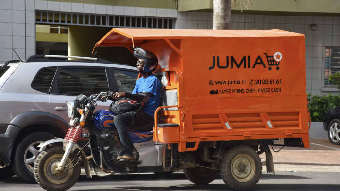 A delivery man drives a transporter with an advertisement for Nigeria's e-commerce site Jumia in the Plateau district of Abidjan on April 24, 2019. - Jumia, the e-commerce site based in Nigeria, became on April 12, 2019 the first African start-up to make its debut on Wall Street. (Photo by ISSOUF SANOGO / AFP)ISSOUF SANOGO/AFP/Getty Images