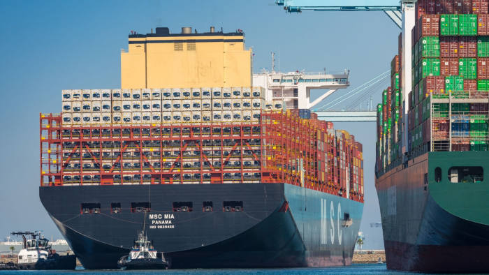 Tugboats guide the Mediterranean Shipping Co. (MSC) Mia container ship arriving at the Port of Los Angeles in Los Angeles, California, U.S., on Wednesday, April 1, 2020. The ship is the largest vessel of its type to ever call in the U.S. and is capable of carrying 23,756 containers. Photographer: Tim Rue/Bloomberg