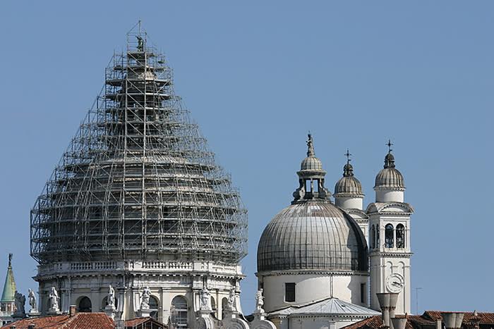 """The iconic emblem of Venice, the church Santa Maria della Salute, symbolises Venice under repair."""