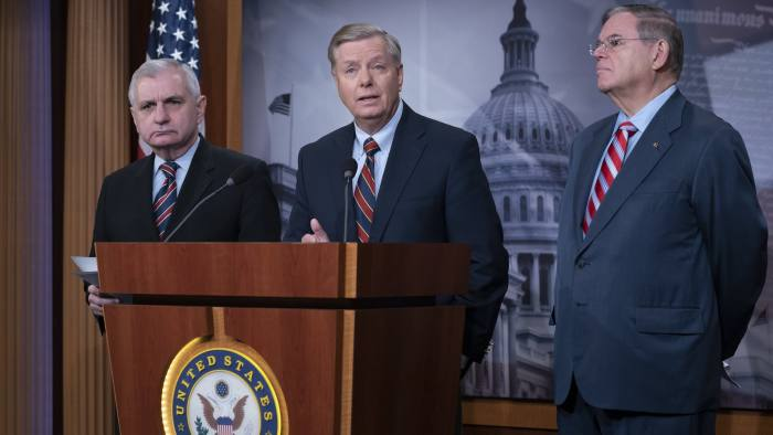 From left, Sen. Jack Reed, D-R.I., Sen. Lindsey Graham, R-S.C., members of the Senate Armed Services Committee, and Sen. Bob Menendez, D-N.J., the ranking member of the Senate Foreign Relations Committee, are disagreeing with President Donald Trump's sudden decision to pull all 2,000 U.S. troops out of Syria, during a news conference at the Capitol in Washington, Thursday, Dec. 20, 2018. (AP Photo/J. Scott Applewhite)