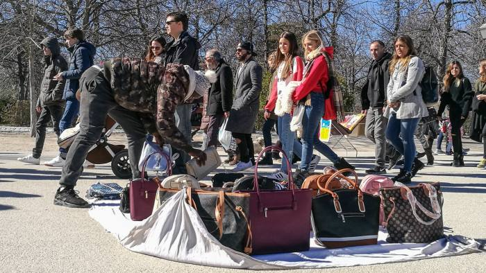 African inmigrants selling illegally falsified handbags of prestigious brands in El Retiro park, in Madrid, Spain. (Photo by Cristina Arias/Cover/Getty Images)