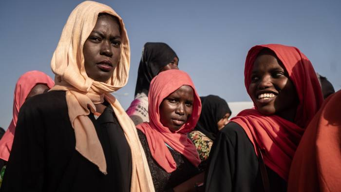 A group of women wearing traditional headscarves attend a demonstration against the military junta outside the Defense Ministry in Khartoum, Sudan, on Monday, April 29, 2019. African leaders gave Sudan's ruling military council more time to hand over power to a transitional government, and urged the international community to provide the embattled nation with urgent aid to support its shift to democracy. Photographer: Fredrik Lerneryd/Bloomberg
