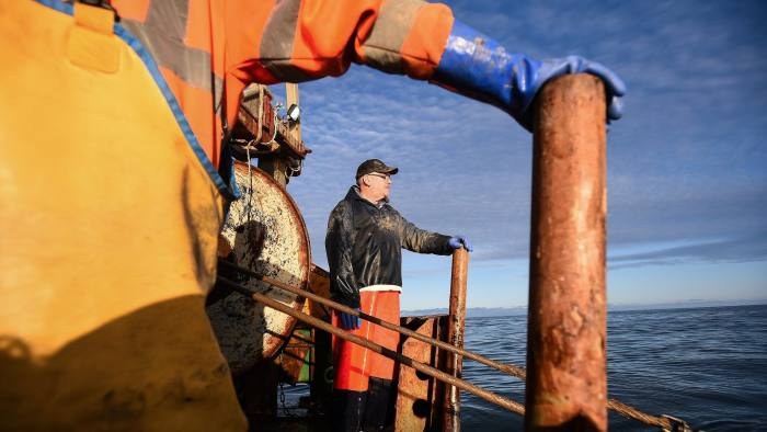 Crewman Gordon Mowbray works fishing for prawns on the fishing trawler 'Scotia Star' in the North Sea off the east coast of Scotland on December 10, 2018. - In the small fishing village of Pittenweem, in southeast Scotland, uncertainty over Brexit is looming large on the North Sea horizon as British Prime Minister Theresa May's divorce deal flounders. (Photo by Andy Buchanan / AFP)        (Photo credit should read ANDY BUCHANAN/AFP/Getty Images)