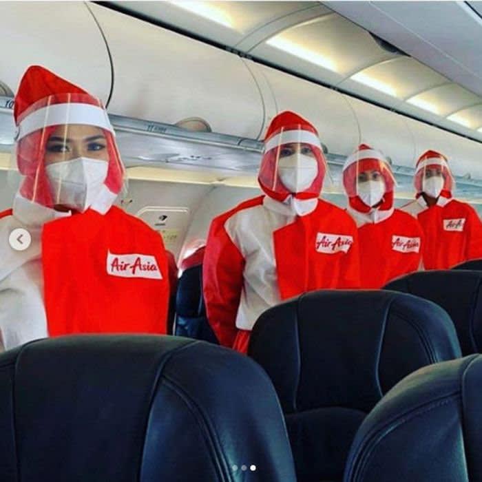 Air Asia uniforms. credit Puey Quinones/ Air Asia