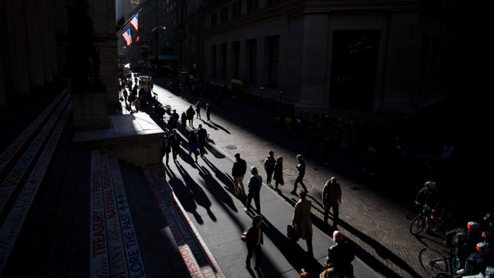 Pedestrians walk along Wall Street near the New York Stock Exchange (NYSE) in New York, U.S., on Monday, Oct. 31, 2016. U.S. stocks rose from a six-week low amid an increase in deal activity as traders assessed the outlook for the presidential election and interest rates in the world's largest economy. Photographer: Michael Nagle/Bloomberg