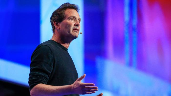 Opening Day Of The Mobile World Congress...Dan Schulman, president and chief executive officer of PayPal Holdings Inc., gestures as he speaks during a keynote session at the Mobile World Congress in Barcelona, Spain, on Monday, Feb. 22, 2016. Mobile World Congress, an annual phone-industry event organized by GSMA Ltd., runs from Feb 22 to Feb 25. Photographer: Pau Barrena/Bloomberg