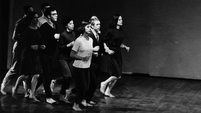 Peter Moore's photograph of (from left) Robert Rauschenberg, Joseph Schlichter (hidden), Sally Gross, Tony Holder, Deborah Hay, Yvonne Rainer, Alex Hay, Robert Morris (behind), and Lucinda Childs performing Rainer's We Shall Run, 1963. Performed at Two Evenings of Dances by Yvonne Rainer, Wadsworth Atheneum, Hartford, March 7, 1965. © Barbara Moore/Licensed by VAGA, New York, NY. Courtesy Paula Cooper Gallery, New York **For all reproductions, the caption for each image must be placed directly below or adjacent to the image, and must follow the format above, with the photographer's name at the beginning of the caption. The copyright credit lines may either be placed alongside each caption, or in a separate credits section, provided that all other copyright and image source credits in the respective publications also appear there. **