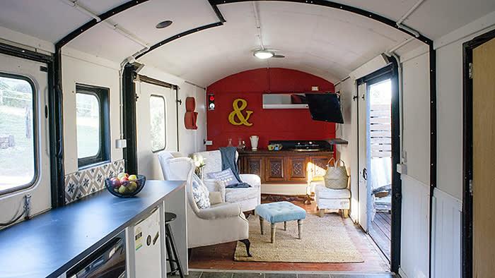 Leanne Kemp at home, near Brisbane. Main living area inside old train carriage (C) Natalie McComas 2018
