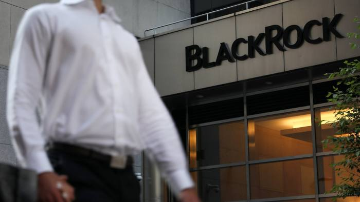 A pedestrian walks past BlackRock Inc. headquarters in New York, U.S, on Wednesday, June 11, 2018. BlackRock Inc. is scheduled to release earnings figures on July 16. Photographer: Bess Adler/Bloomberg