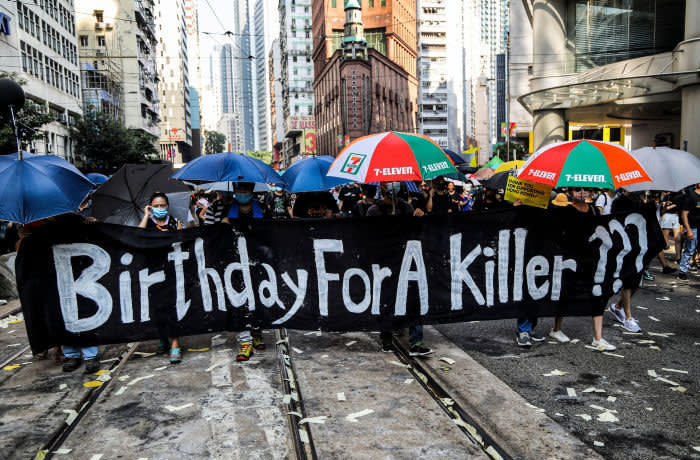 Mandatory Credit: Photo by VIVEK PRAKASH/EPA-EFE/Shutterstock (10431742af) Anti-government protesters carry an anti-China banner that reads 'Birthday For A Killer' while marching through the streets in protest on National Day in Hong Kong, China, 01 October 2019. Hong Kong has witnessed several months of ongoing mass protests, originally triggered by a now withdrawn extradition bill to mainland China that have turned into a wider pro-democracy movement. Anti-Government protests during China's National Day in Hong Kong - 01 Oct 2019