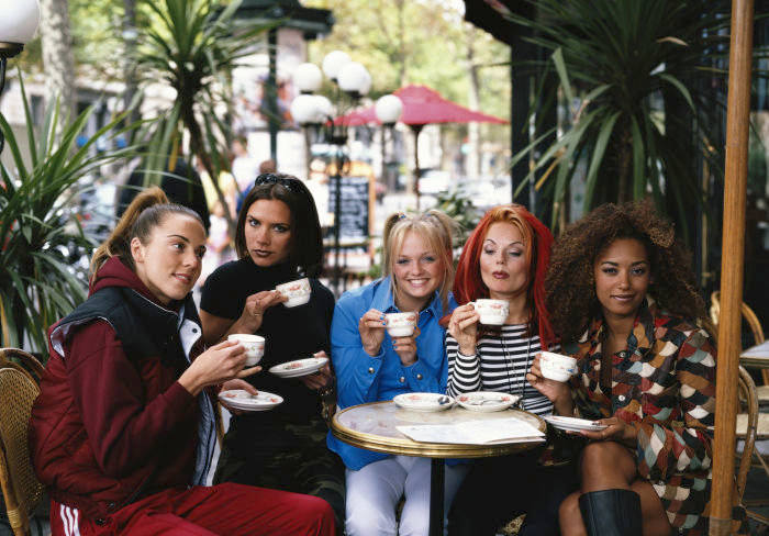 English pop group The Spice Girls on a cafe terrace, Paris, September 1996. Left to right: Melanie Chisholm, Victoria Beckham, Emma Bunton, Geri Halliwell and Melanie Chisholm, aka Sporty, Posh, Baby, Ginger and Scary Spice. (Photo by Tim Roney/Getty Images)