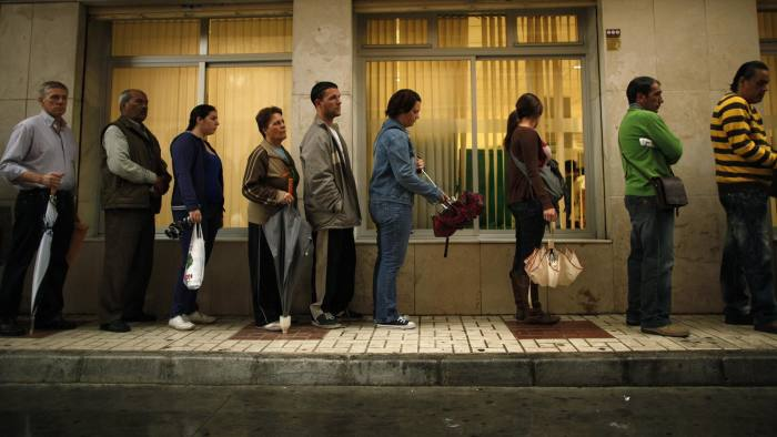 To match Insight EUROPE/LABOUR...People wait in line to enter a government job centre in Malaga, southern Spain in this April 29, 2011 file photo. Europe's relative lack of labour mobility can be pinned on cultural obstacles, as well as increasingly choosy employers and stiff competition from established migrants. For Spaniards, in particular, Europe is not working, and this highlights a structural trend just at the time the region needs to make the most of its single market for workers. To match Insight EUROPE/LABOUR REUTERS/Jon Nazca/Files (SPAIN - Tags: BUSINESS EMPLOYMENT POLITICS)