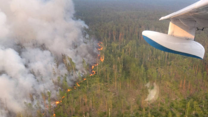 "This handout picture taken on July 30, 2019 from onboard a Be-200 firefighting aircraft and provided by the press-service of Russia's Krasnoyarsk Krai's forestry ministry shows a forest fire in the Boguchansky district. (Photo by HO / press-service of Russia's Krasnoyarsk Krai's forestry ministry / AFP) / RESTRICTED TO EDITORIAL USE - MANDATORY CREDIT ""AFP PHOTO / press-service of Russia's Krasnoyarsk Krai's forestry ministry / HO"" - NO MARKETING NO ADVERTISING CAMPAIGNS - DISTRIBUTED AS A SERVICE TO CLIENTSHO/AFP/Getty Images"