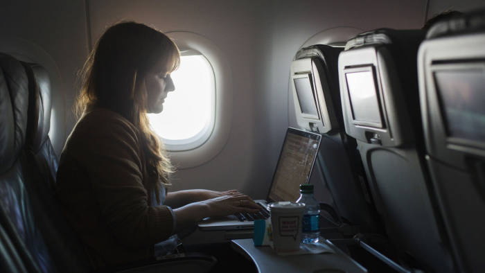 Ms Wolf-at-the-Door flips open the lid of her laptop the moment we are airborne and hammers away at her keyboard throughout the entire flight