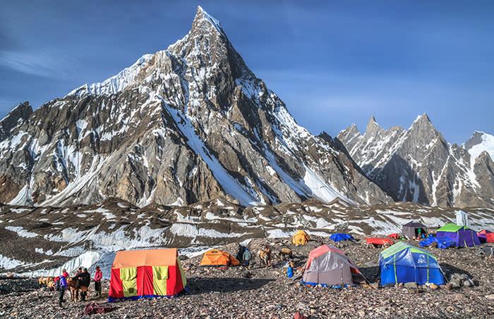 View of Concordia campsite on Baltoro glacier, beneath the impressive Mitre Peak (6,010 m / 19,720 ft), a mountain in the Karakoram range, located in Central Karakoram National Park (CKNP), Gilgit-Baltistan region, northern Pakistan.