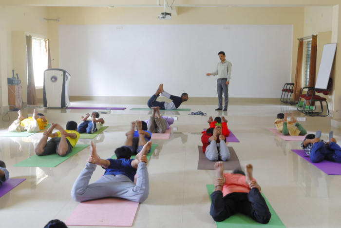 13 Dec 2018 - Bangalore , INDIA. Dr. Hemant teaches yoga postures to the patients at the Yoga Center at NIMHANS. (Subhash Sharma for FT)