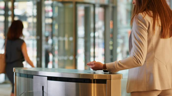 Smart watch scanning to open gate in business lobby gaining access