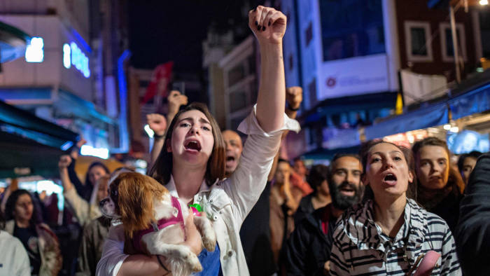 Supporters of Ekrem Imamoglu, the opposition party candidate who won the March election, protest in Istanbul on Monday evening