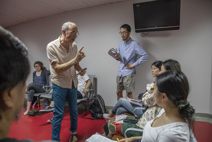 Beijing August 15th, 2018 British director Tim Supple in talk with actors ahead of a performance of a Chinese production of Shakespeare's The Tempest at the National Centre for Performing Arts. Gilles SabriÈ for The Financial Times