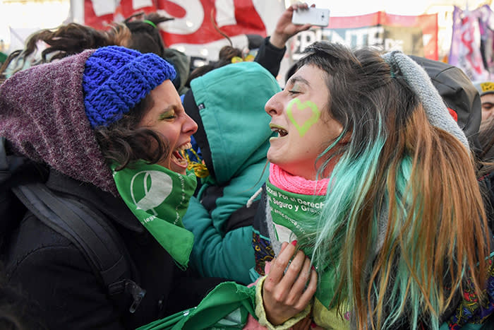 Pro-choice activists react outside the Argentine Congress in Buenos Aires, on June 14, 2018, shortly after lawmakers approved a bill to legalize abortion. Lawmakers in Pope Francis' native Argentina on Thursday narrowly approved a bill to legalize abortion during the first 14 weeks of pregnancy. The lower house Chamber of Deputies passed the bill by 129 votes to 125. The bill now goes before the Senate. / AFP PHOTO / EITAN ABRAMOVICHEITAN ABRAMOVICH/AFP/Getty Images