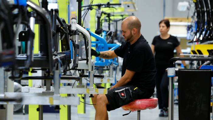 Employees work on electric bicycles at the production plant of e-bike manufacturer Riese & Mueller in Muehltal near Darmstadt, Germany, August 30, 2019. Picture taken August 30, 2019. REUTERS/Ralph Orlowski