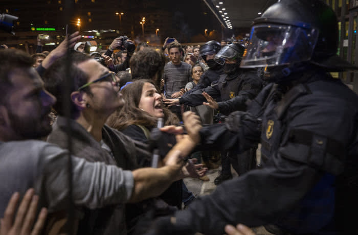 Catalan pro-independence protesters scuffle with by Catalan police, as they try to block the entrance of the main train station, during a demonstration in Barcelona, Spain, Monday, Oct. 28, 2019. The protest organised by the Committees for the Defense of the Republic, also known as CDRs, have prompted police to form a security perimeter around the train station to block demonstrators from disrupting travellers. (AP Photo/Emilio Morenatti)