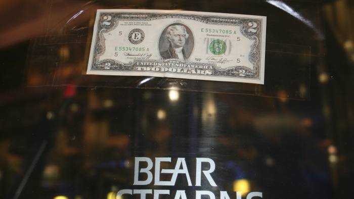 A U.S. two dollar bill is taped to the revolving door leading to the Bear Stearns global headquarters in New York...A U.S. two dollar bill is taped to the revolving door leading to the Bear Stearns global headquarters in New York March 17, 2008. JPMorgan Chase & Co said on Sunday it would buy stricken rival Bear Stearns for just $2 a share in an all-stock deal that values the U.S. investment bank at the centre of the credit crisis at about $236 million. REUTERS/Kristina Cooke (UNITED STATES)