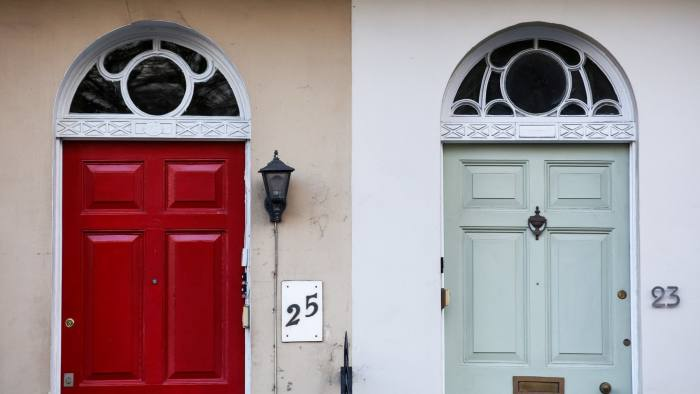 Entrance doors to neighboring residential properties stand together in Cheltenham, U.K., on Thursday, Jan. 4, 2018. Cheltenhamin southwest England saw a 13 percent jump in prices in 2017, almost five times the national increase of 2.7 percent,Bank of Scotland Plc's Halifax division said Tuesday.Photographer: Luke MacGregor/Bloomberg