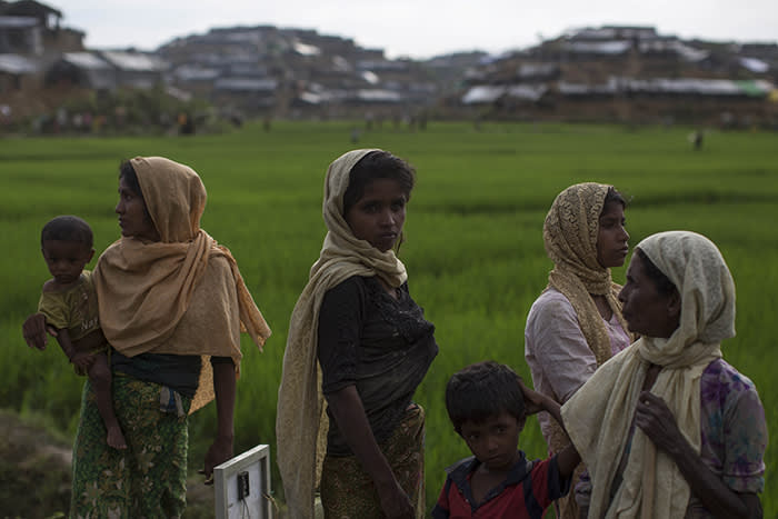 WHAIKHYANG, BANGLADESH - SEPTEMBER 10:  Rohingya refugees gather by the side of the road after arriving from Myanmar on September 10, 2017 in Whaikhyang, Bangladesh. Recent reports have suggested that around 290,000 Rohingya have now fled Myanmar after violence erupted in Rakhine state. The 'Muslim insurgents of the Arakan Rohingya Salvation Army' have issued statement that indicates that they are to observe a cease fire, and have asked the Myanmar government to reciprocate.  (Photo by Dan Kitwood/Getty Images)