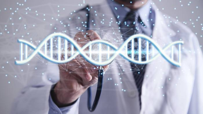 Doctor with spiral DNA molecules. Structure of the genetic code. Medicine concept. Genome, professional. CREDIT - Andranik Hakobyan | Dreamstime.com