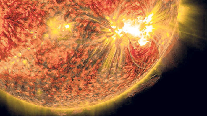 The bright light in the lower right of the sun shows an X-class solar flare on Oct. 26, 2014, as captured by NASA's SDO. This was the third X-class flare in 48 hours, which erupted from the largest active region seen on the sun in 24 years. This flare was classified as an X2.0-class flare and it peaked at 6:56 a.m. EDT.