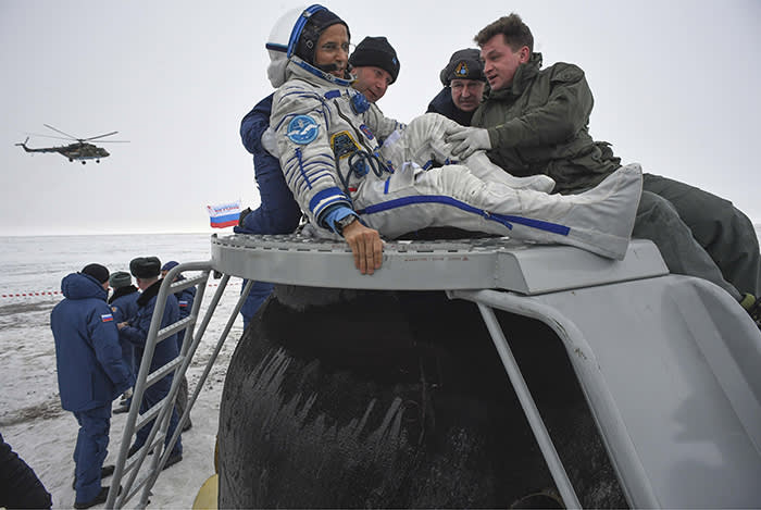 TOPSHOT - Ground personnel help NASA astronaut Joe Acaba to get out of the Soyuz MS-06 space capsule after landing in a remote area outside the town of Dzhezkazgan (Zhezkazgan), Kazakhstan, on February 28, 2018. Two NASA astronauts and a Russian cosmonaut returned to Earth on February 28, 2018, rounding off a mission of more than five months aboard the International Space Station. Alexander Misurkin of Russia's Roscosmos space agency and NASA's Mark Vande Hei and Joe Acaba touched down on steppe land southeast of the town of Dzhezkazgan in central Kazakhstan at the expected time of 0231 GMT. / AFP PHOTO / POOL / ALEXANDER NEMENOVALEXANDER NEMENOV/AFP/Getty Images