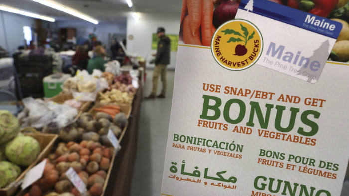 In this Friday, March 17, 2017 photo a sign advertises a program that allows food stamp recipients to use their EBT cards to shop at a farmer's market in Topsham, Maine. Republican governor Paul LePage and several Republican legislators nationwide say they hope that Republican President Donald Trump will support banning food stamps to purchase junk food like soda. (AP Photo/Robert F. Bukaty)