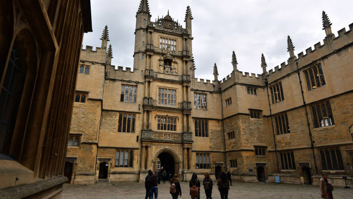 OXFORD, ENGLAND - SEPTEMBER 20: Tourists visit the Bodleian Library on September 20, 2016 in Oxford, England. Oxford University has taken number one position in the 2016-2017 world university rankings beating off Harvard and Cambridge for the top spot. (Photo by Carl Court/Getty Images)