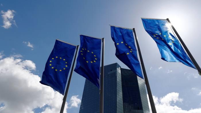 FILE PHOTO: European Union flags flutter outside the European Central Bank (ECB) headquarters in Frankfurt, Germany, April 26, 2018. REUTERS/Kai Pfaffenbach/File Photo