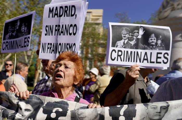 Protesters shout slogans and carry banners with the photo of Adolf Hitler and Francisco Franco during a demonstration outside Madrid's Supreme Court calling on the government to ban the burial of Spanish dictator Francisco Franco in the Almudena Cathedral in Madrid, after his exhumation from the Valley of the Fallen, in Madrid, Spain, on September 24, 2019. The banner reads