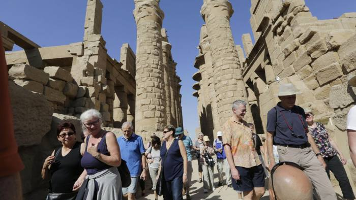 German Tourists visit the Karnak Temple in Luxor, Egypt, Friday, Nov. 6, 2015. Elsewhere, hundreds of British tourists stranded in the Egyptian resort of Sharm el-Sheikh waited anxiously Friday for flights home as budget carrier easyJet said the Egyptian government had disrupted some of its flights out of Sinai, the site of a Russian jetliner crash.(AP Photo/Amr Nabil)