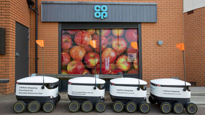 Co Op Opening Emerson Valley Milton Keynes with Delivery Robots and children from Howe Park School help with ribbon cutting.