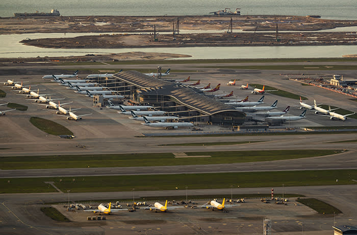 HONG KONG, CHINA - 2020/04/12: An overview of the Hong Kong International Airport with many planes parked. Coronavirus strikes hard around the world, many countries decide to lock. Some airlines are promoting discounts while others are adding flights to help residents abroad get home. (Photo by May James / SOPA Images / LightRocket via Getty Images)