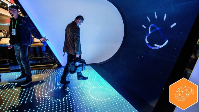 A man walks through the Watson Premier display to learn about IBM Watson at CES in Las Vegas, Nevada, January 9, 2018. / AFP PHOTO / DAVID MCNEW (Photo credit should read DAVID MCNEW/AFP/Getty Images)