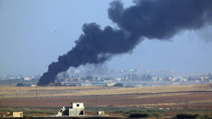 In this photo taken from the Turkish side of the border between Turkey and Syria, in Akcakale, Sanliurfa province, southeastern Turkey, smoke billows from a fire inside Syria during bombardment by Turkish forces Wednesday, Oct. 9, 2019. Turkey launched a military operation Wednesday against Kurdish fighters in northeastern Syria after U.S. forces pulled back from the area, with a series of airstrikes hitting a town on Syria's northern border.(AP Photo/Lefteris Pitarakis)