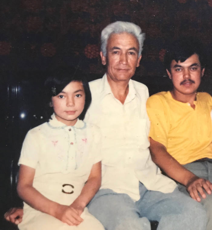 From left: Gulruy Asqar as a child, with her uncle and Husenjan Asqar, her brother, who was detained in 2018. As a translator, he had worked on several Uighur-Han Chinese dictionaries