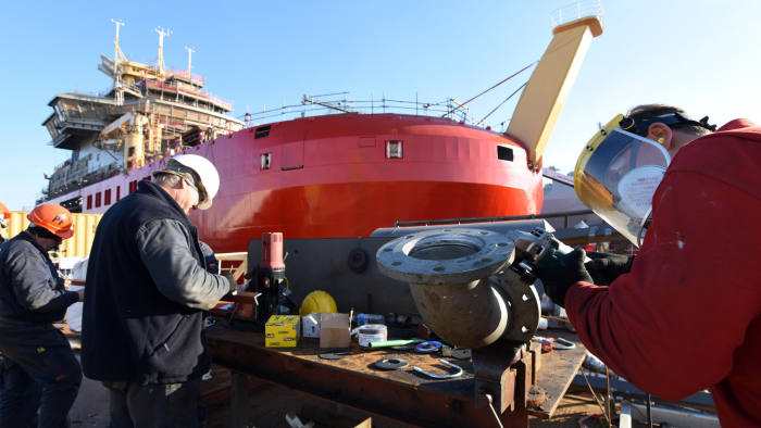 Engineers work on components for the Sir David Attenborough ice breaking vessel (pictured) at Cammell Laird shipyard, Birkenhead.