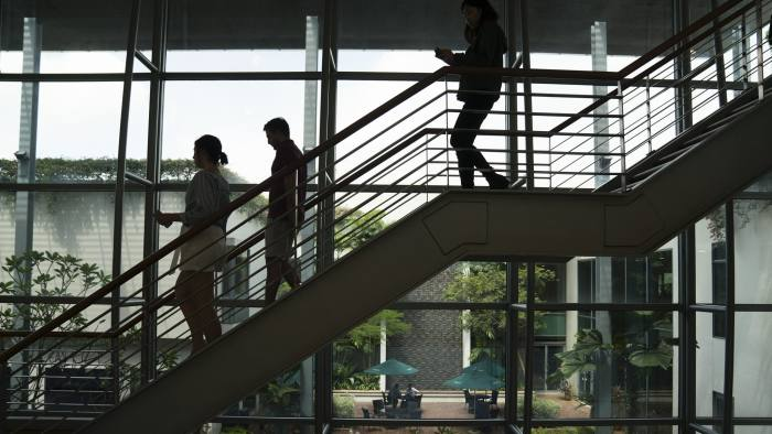 People walk down a set of stairs at the INSEAD Business School in Singapore, on Monday, Nov. 13, 2017. INSEADhad a perennial problem with its MBAs. The grades of female students consistently lagged those of men.So a professor did an experiment: She hadall students, male and female, take a test to affirm their core values -- and managed to improve the grades of the women by 89 percent. Photographer: Wei Leng Tay/Bloomberg